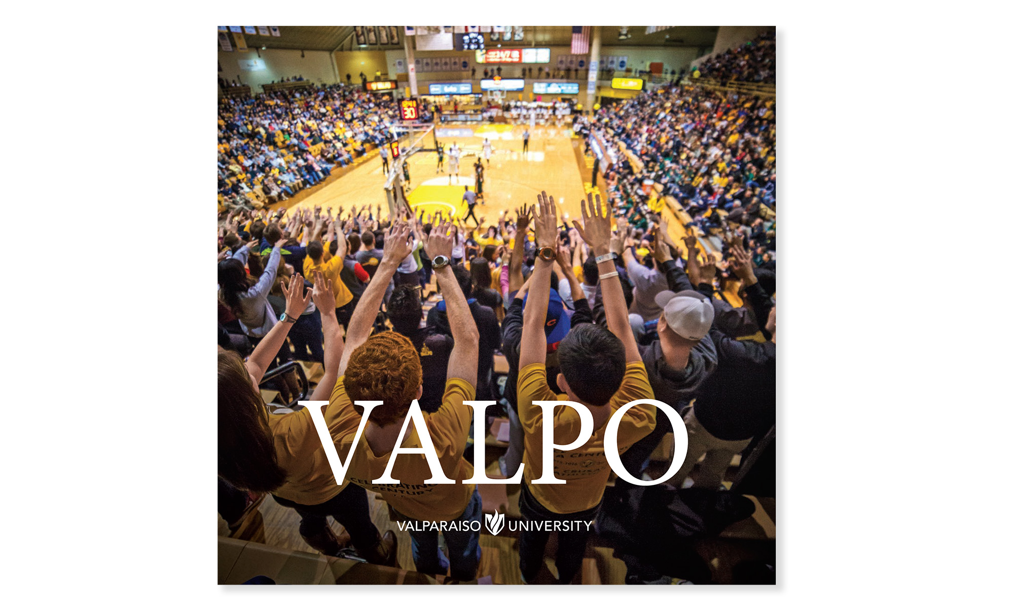 Brochure cover showing crowd at a basketball game.