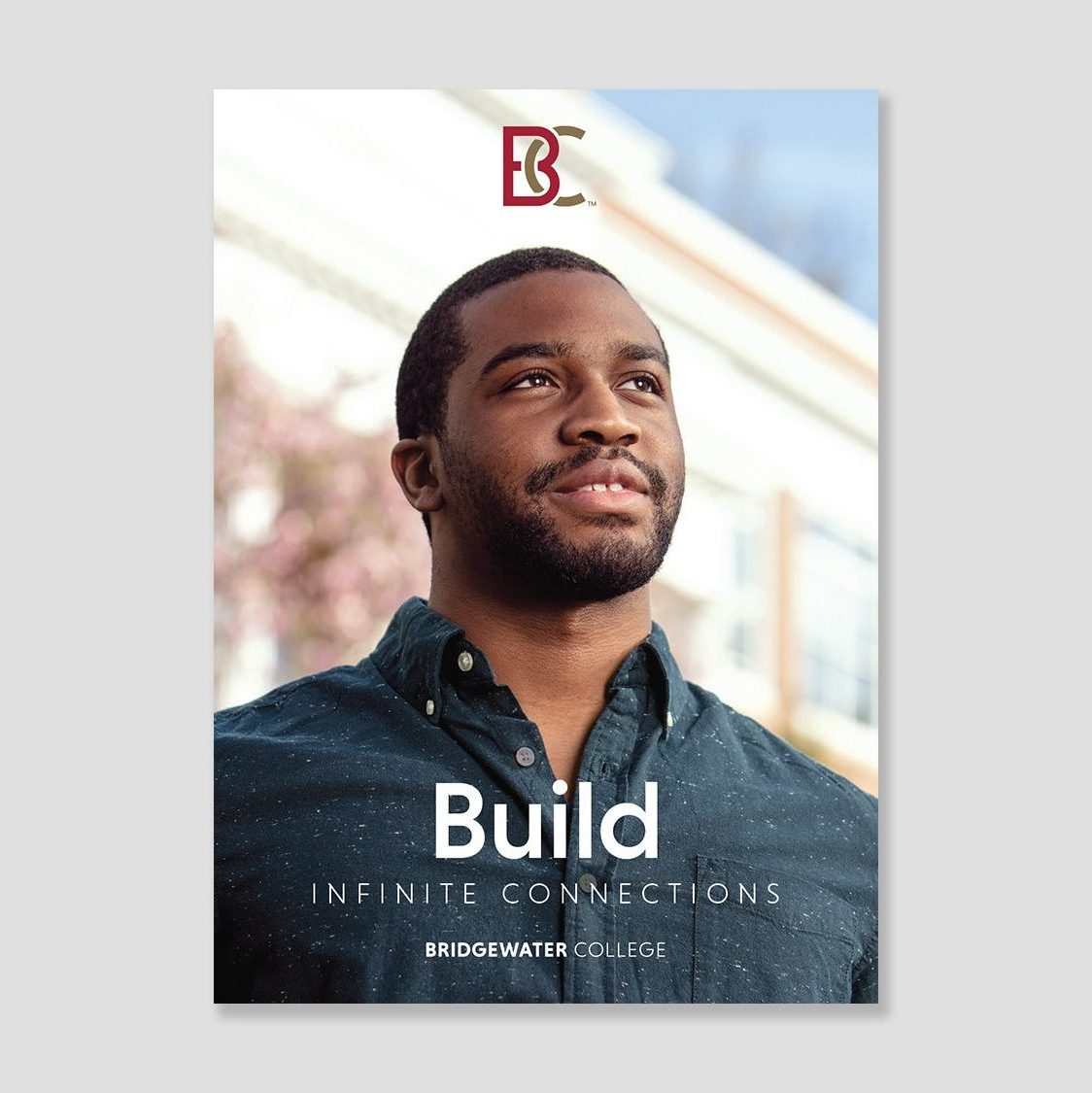 Brochure cover showing a young black man. Image text: Build infinite connections.