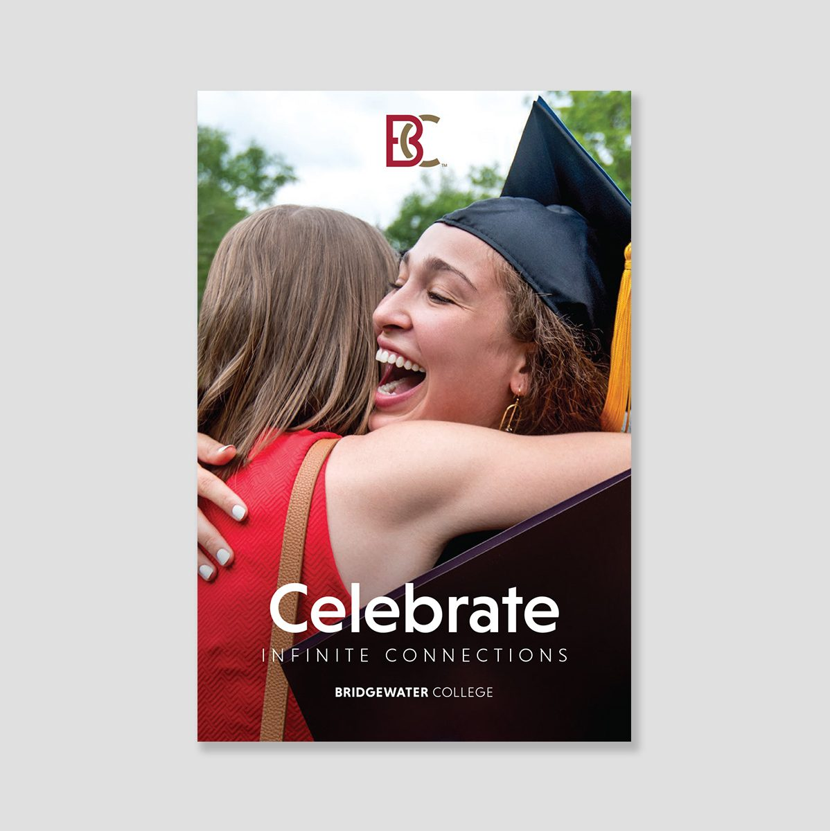 Brochure cover showing two women hugging, one wearing a graduation cap and gown. Text: Celebrate infinite connections.