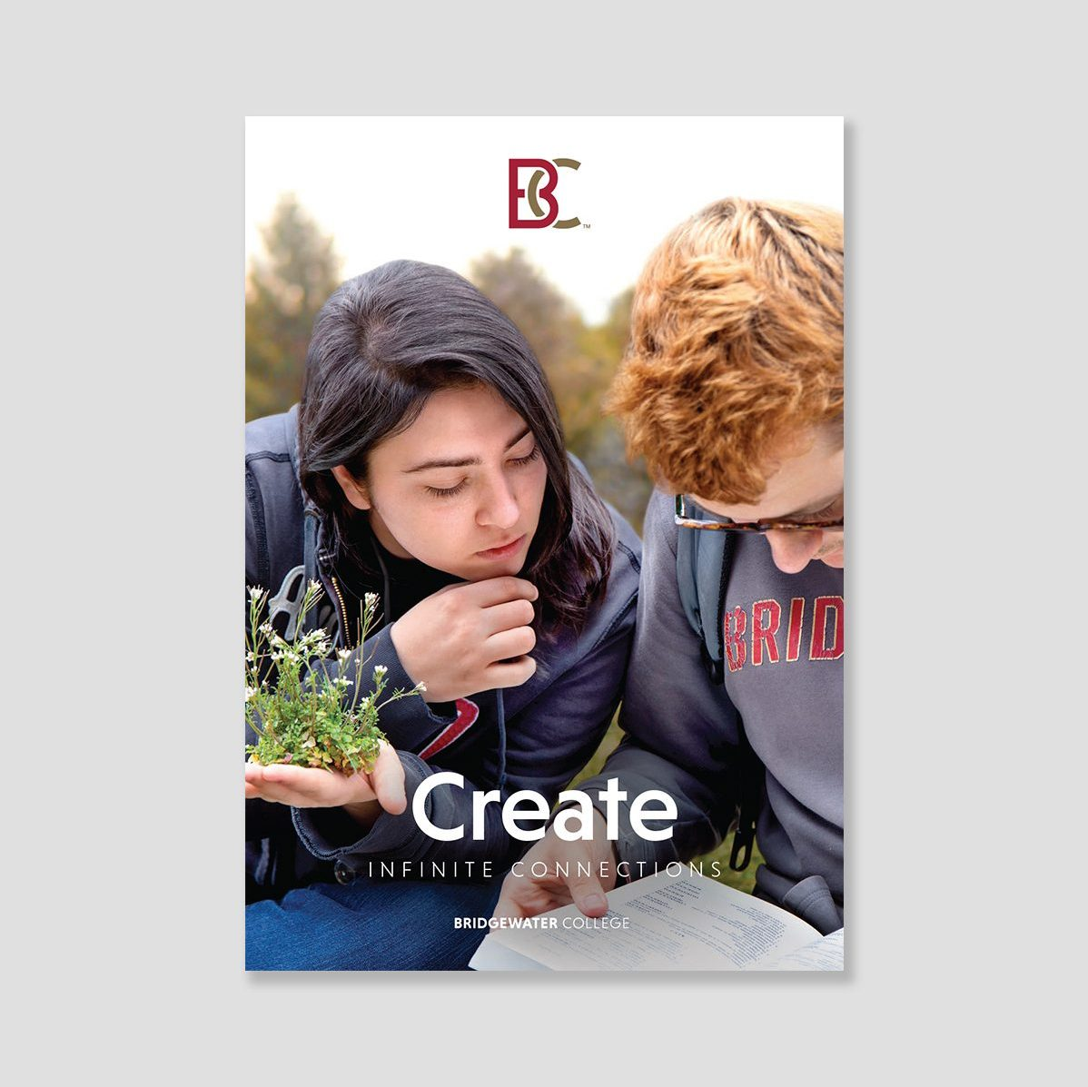 Brochure cover showing two students. Text: Create infinite connections.
