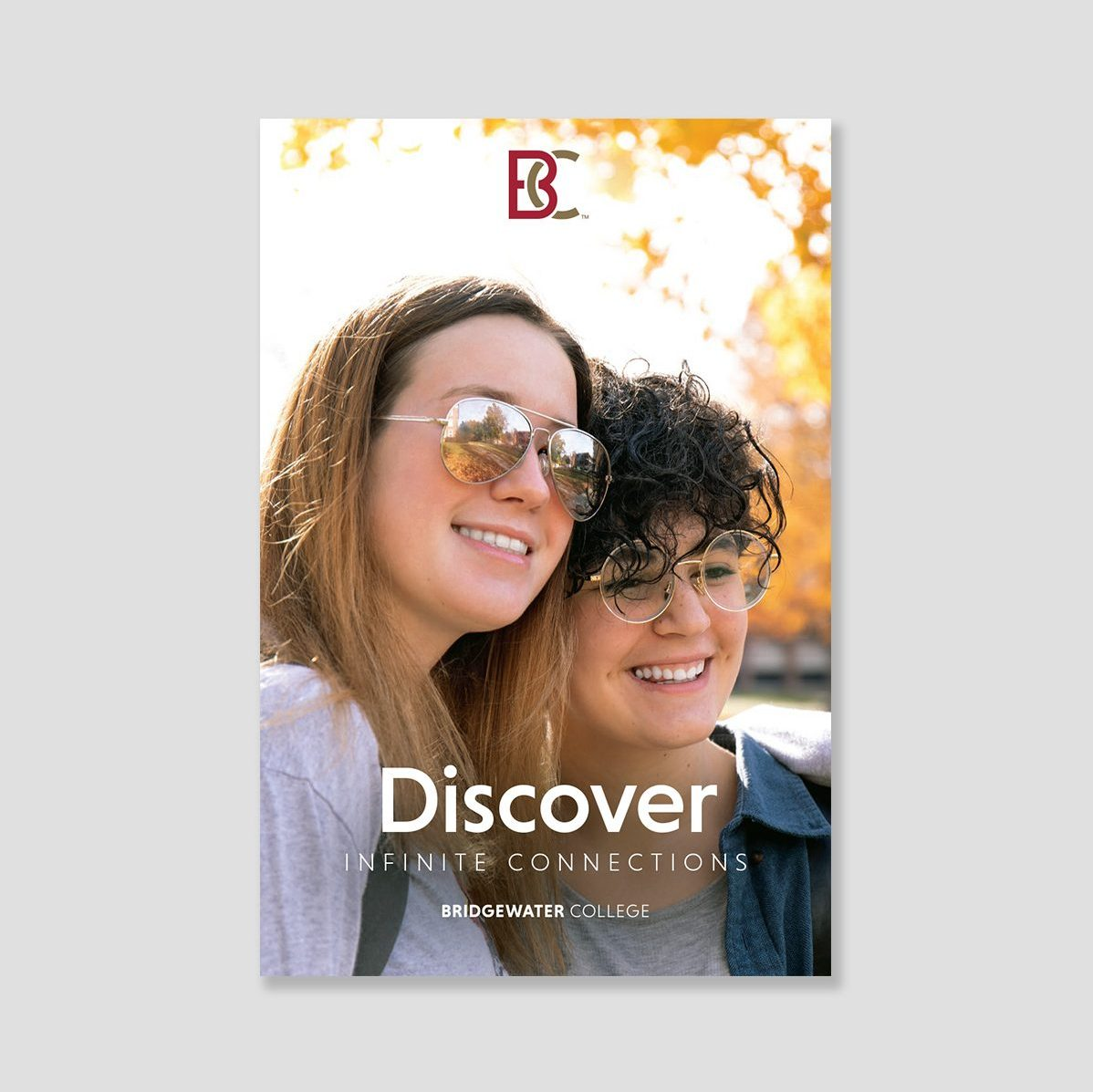Brochure cover showing two young white women. Text: Discover infinite connections.