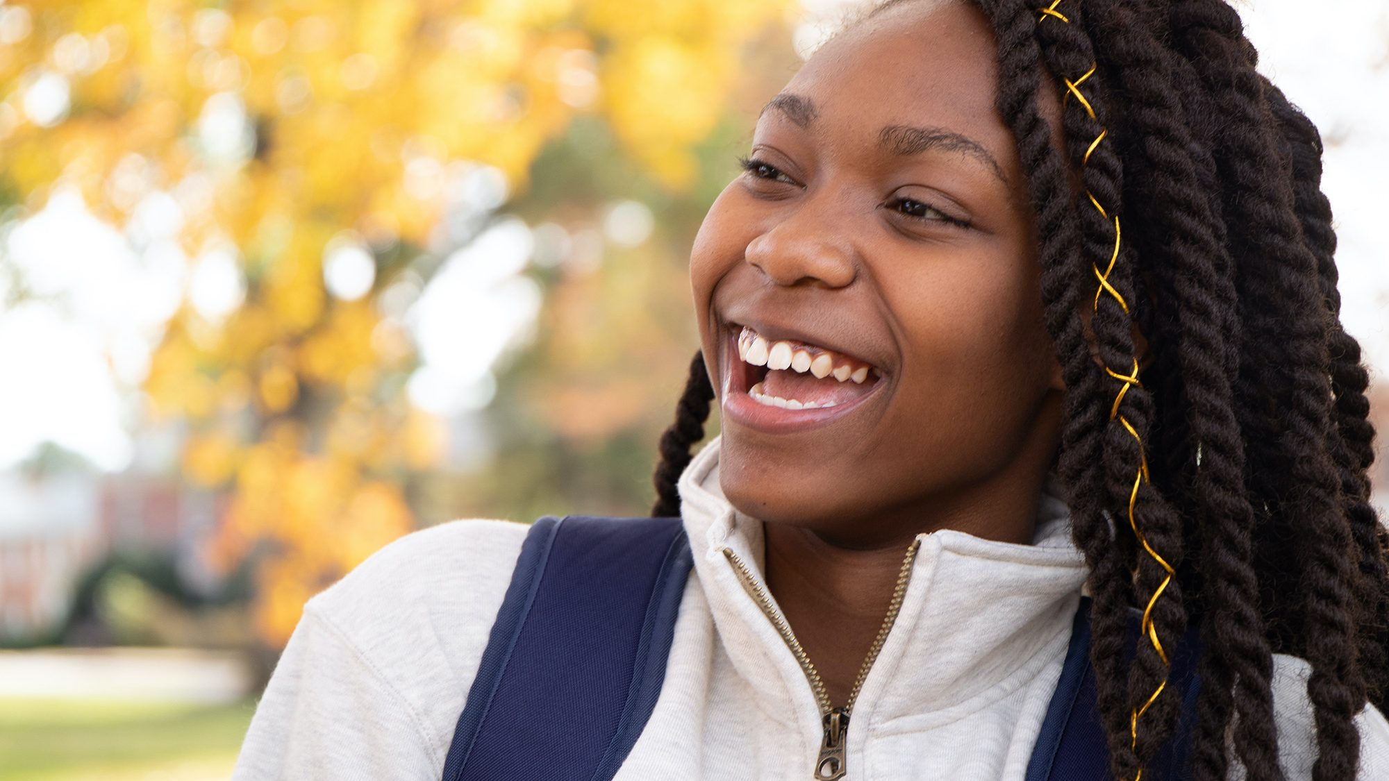 Young Black woman smiling.