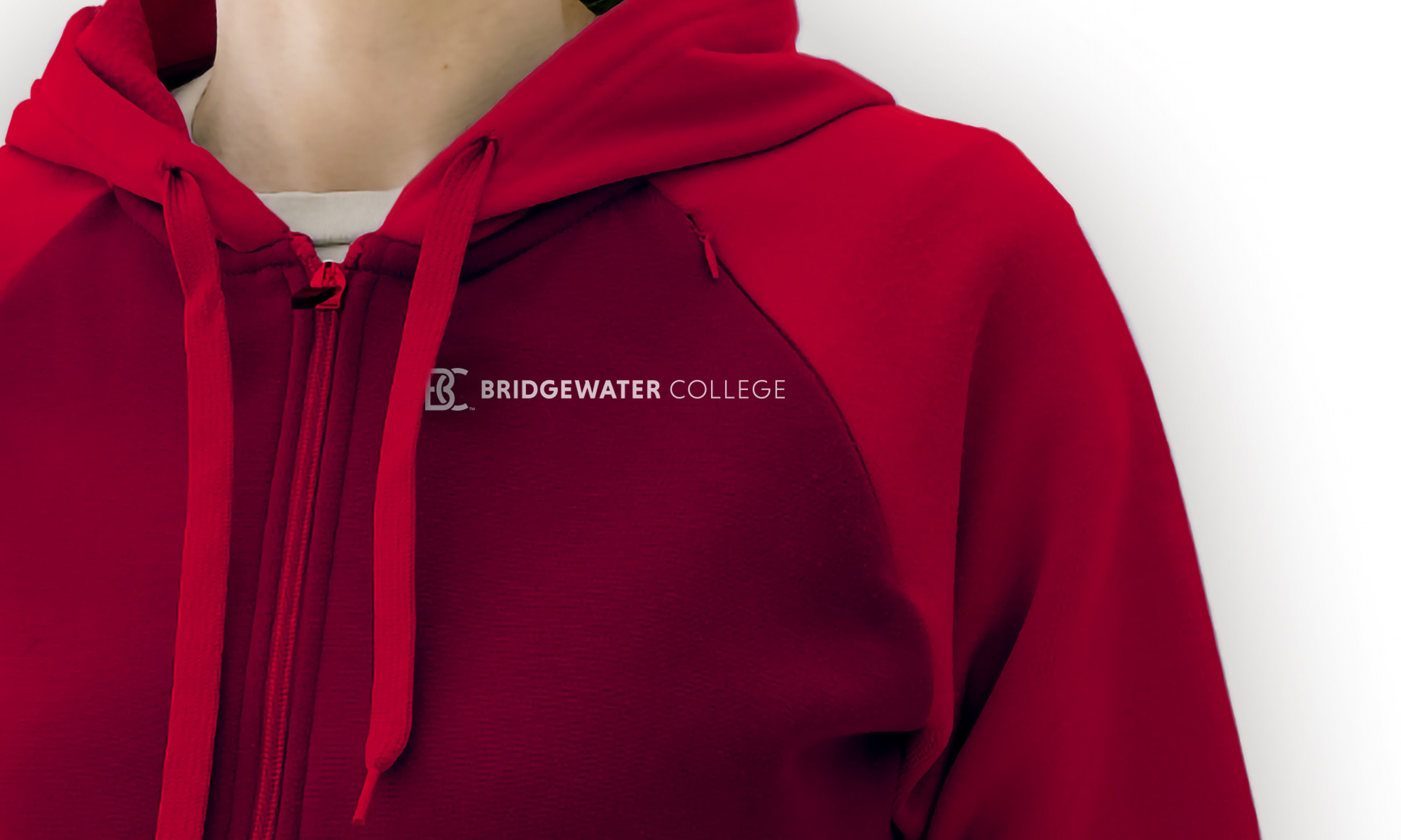 A red hoodie with the new logo.