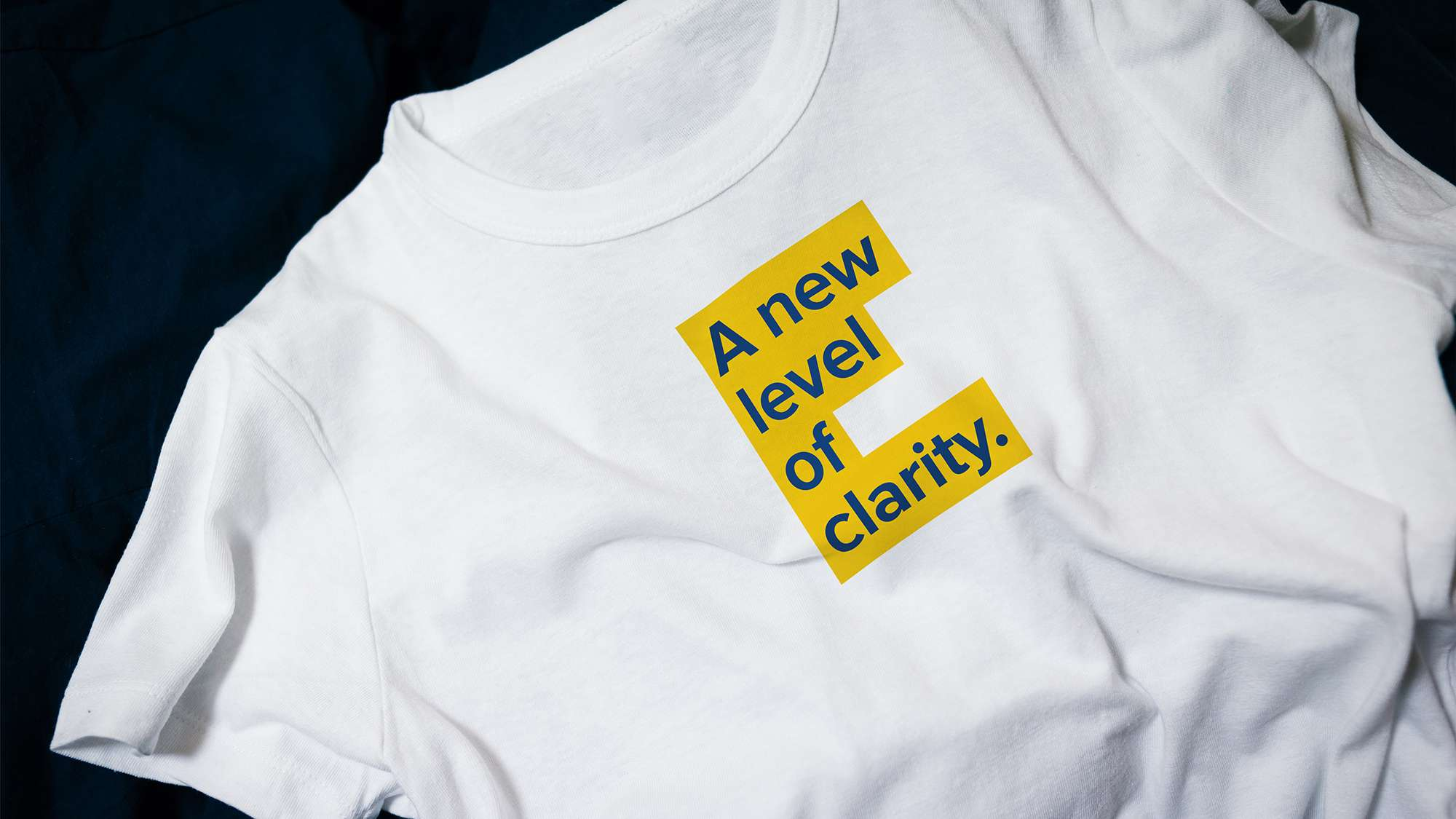 A new level of clarity, text on a tee shirt.